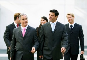 Business executives walking and talking together